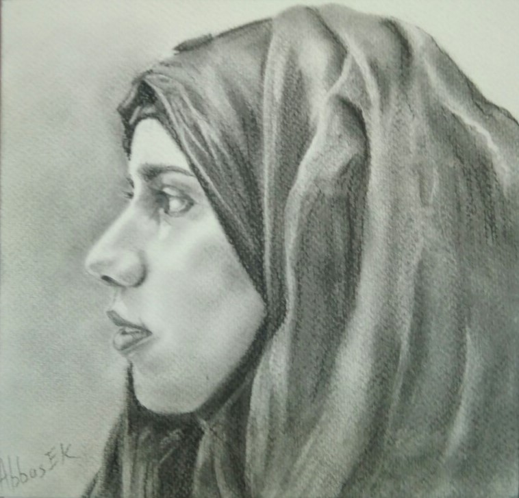 Charcoal portrait of a girl wearing a hijab