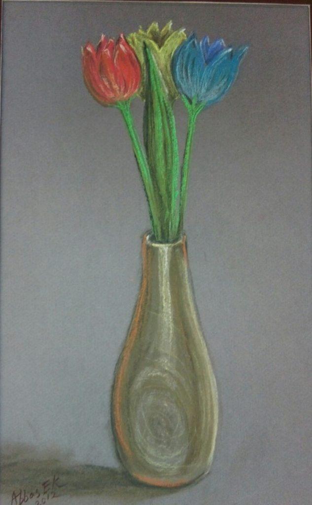 Still-life of three tulips in a jar